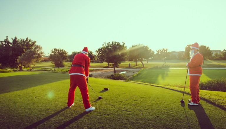 Golfen Weihnachtsmänner